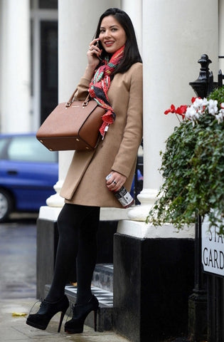 Olivia Munn with her Michael Kors Large Selma bag