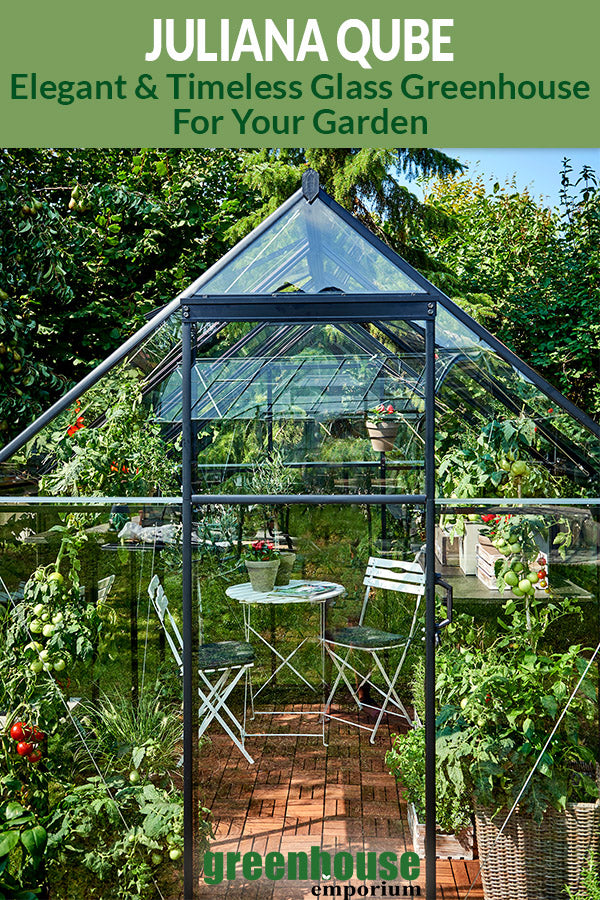 Front view of a glass greenhouse with the text: Juliana Qube - Elegant and timeless glass greenhouse for your garden