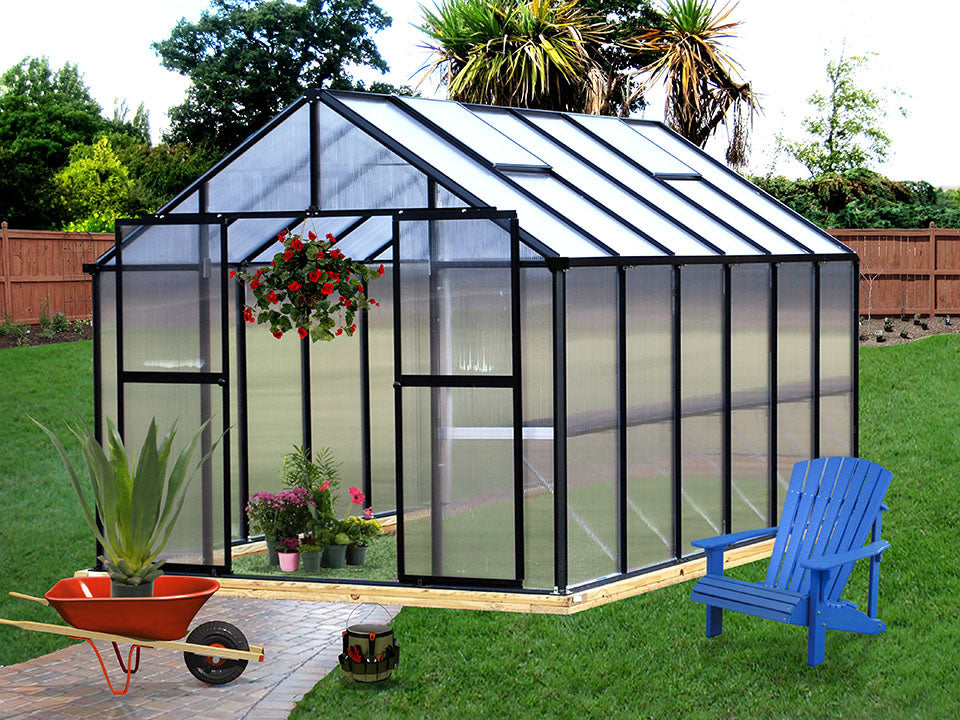 Monticello Premium Edition Greenhouse with black frame in a garden