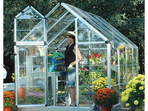 Image of Palram 6ft x 8ft Snap & Grow Hobby Greenhouse - window and door open - woman gardening inside