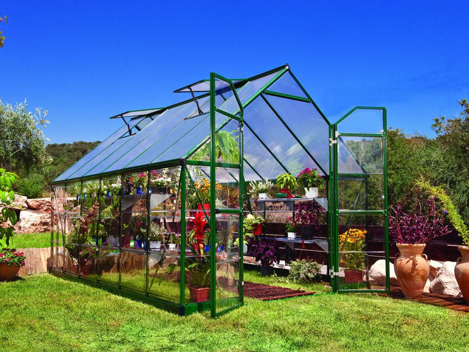Palram 8ft x 12ft Balance Hobby Greenhouse - HG6112G - in a garden setting