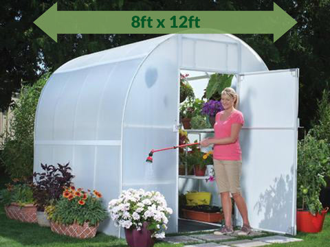 Solexx 8ft x 12ft Gardener's Oasis Greenhouse G-212 - open door - a woman watering the flowers outside - green arrow on top showing dimensions