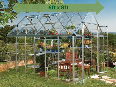 Palram 8ft x 12ft Snap & Grow Hobby Greenhouse - HG8012 - full image - in a garden - green arrow on top