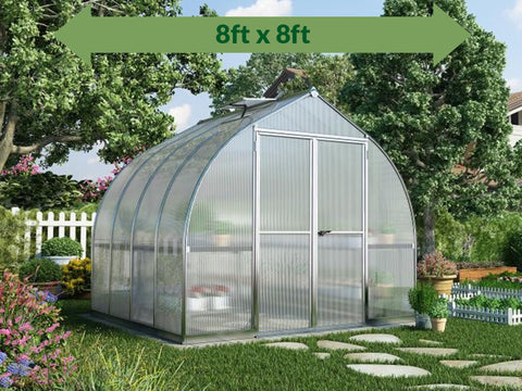 Image of Palram Bella Silver 8ft x 8ft Hobby Greenhouse HG5408 - full view - with green arrow on top - in a garden