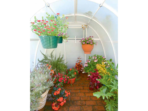 Image of Solexx  8ft x 8ft Early Bloomer Greenhouse G-108 - interior view - with plants and flowers