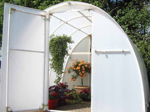 Image of Solexx  8ft x 8ft Early Bloomer Greenhouse G-108 - front view with open door - plants and flowers inside