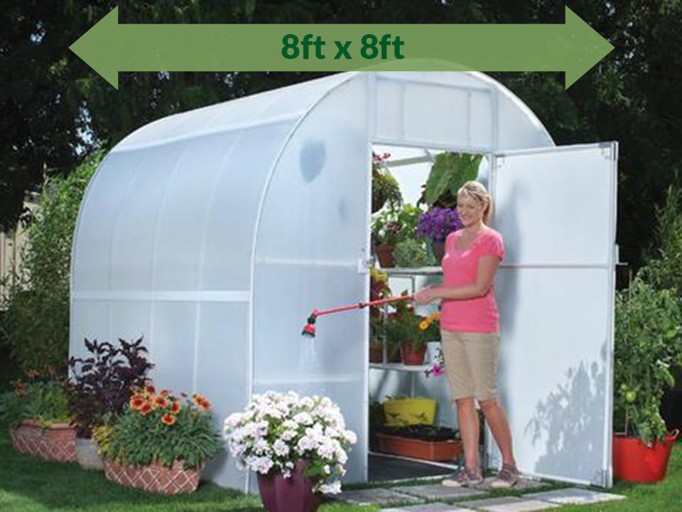 View of Solexx 8ft x 8ft Gardener's Oasis Greenhouse G-208 - green arrow on top showing dimensions -  a woman outside watering flowers