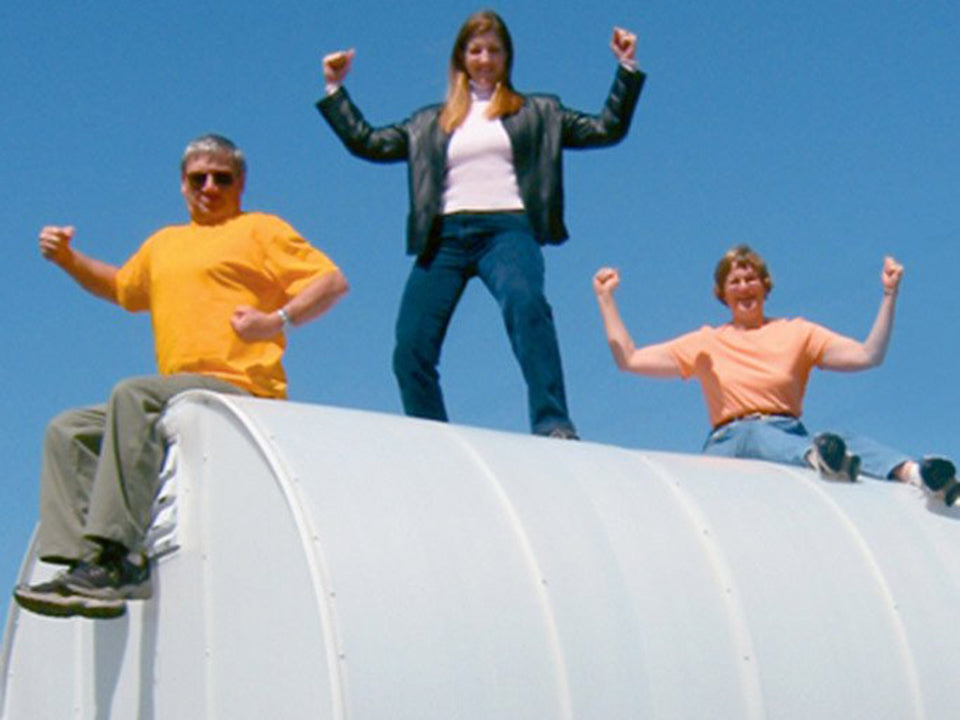 Solexx 8ft x 8ft Gardener's Oasis Greenhouse G-208 - three people on top showing how strong the greenhouse is