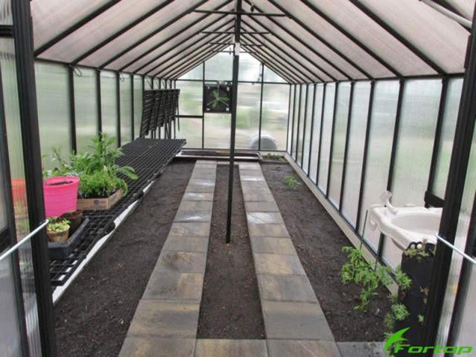 Riverstone Monticello Greenhouse 8x20 - Mojave Package - interior view with plants and flowers