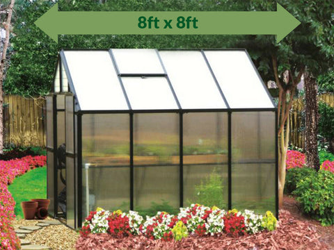 Riverstone Monticello Greenhouse 8x8 - Premium Package - side view - green arrow on top showing dimensions - in a garden