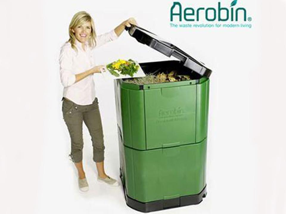 Aerobin 400 Insulated Composter - with a woman on the side pouring compost into the bin - gray background