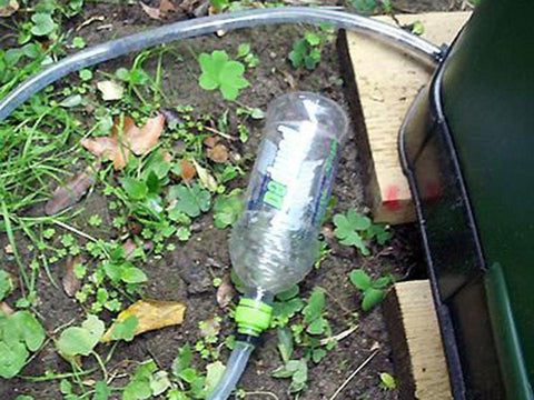 Image of Aerobin 400 Insulated Composter with a pipe attached to a bottle