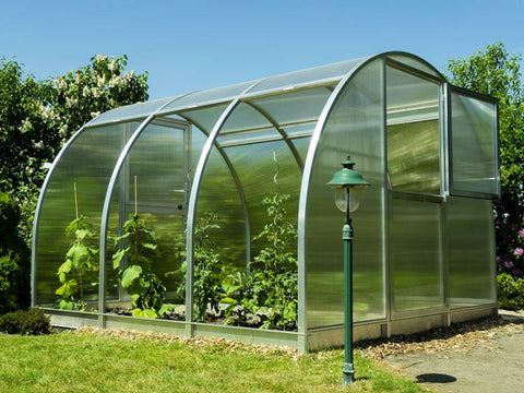Image of Side view of Arcus Greenhouse showing all side panels are fully lifted and the top section of the front door is open