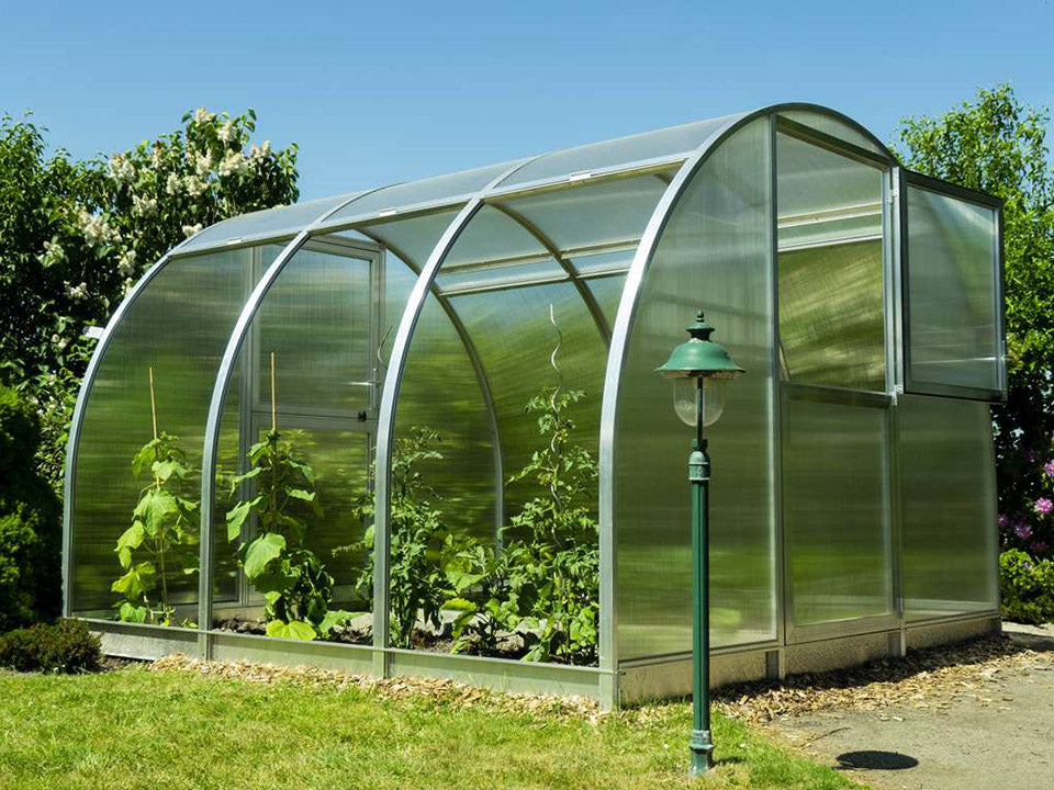 Side view of Arcus 3 Greenhouse - all three sections are opened - opened top section of the door