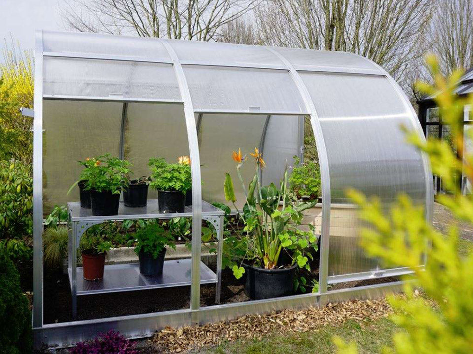 Side view of Arcus 3 Greenhouse with plants inside and two side panels lifted