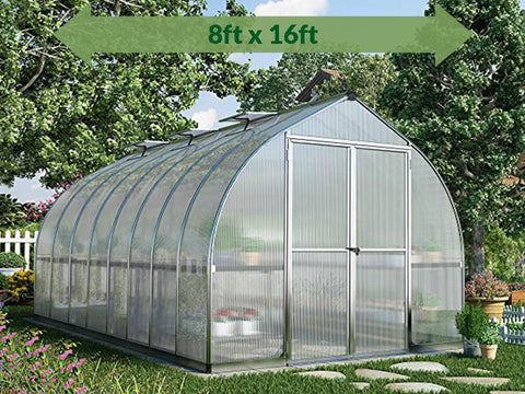 Palram Bella Silver 8ft x 16ft Hobby Greenhouse HG5416 - full view - with a green arrow on top - in a garden