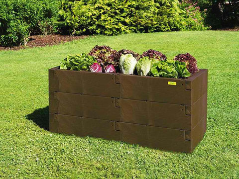 Triple Dark brown timber raised bed with grown vegetables