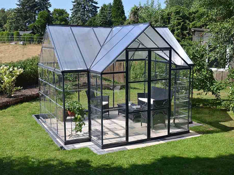 Palram Chalet 12ft x 10ft Hobby Greenhouse HG5400 - full view - in a garden