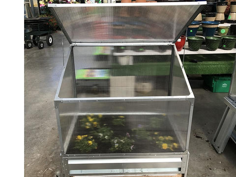Image of Delta Park Single Cold Frame. Top view. Open Roof panel. With Plants inside