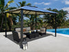 Image of Durham 10x13 Hard Top Gazebo with a living area set beside the pool