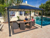 Image of Durham 10x13 Hard Top Gazebo with a dining area set beside the pool