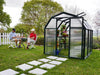 Image of Rion 6ft x 8ft EcoGrow 2 Twin-Wall Greenhouse - HG7008 - full view - open door - in a garden