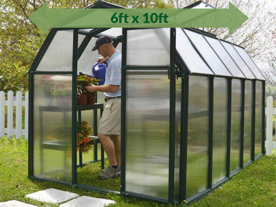Rion 6ft x 10ft EcoGrow 2 Twin Wall Greenhouse - HG7010 - full view - green arrow on top - in a garden