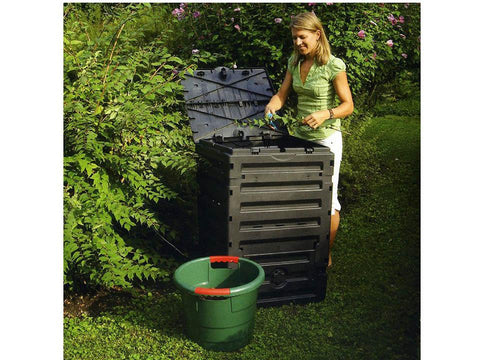 Eco Master 300 Compost Bin and a woman cutting the stem and putting it into the Bin.