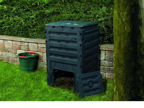 Eco Master 450 Compost Bin with an open bottom. There is also a green pail beside the bin on the left side.