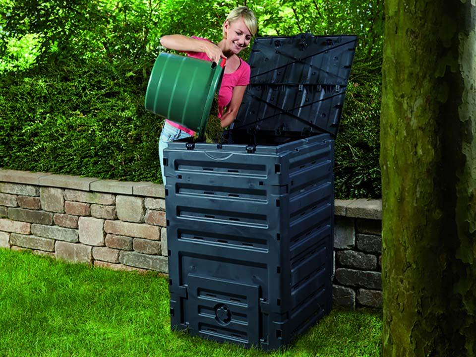 Eco Master 450 Compost Bin and a woman pouring compost into the bin.
