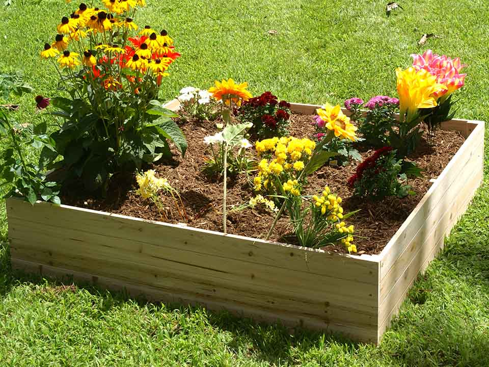 The Eden Garden Bed with Trellis can be used with or without the trellis