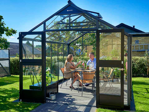 Juliana Premium Greenhouse 9ft x 14ft Anthracite 3mm safety glass with two people inside