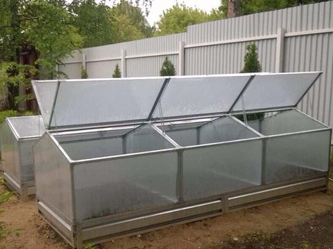 Three attached Delta Park Gable Roof Cold Frame with open roof panels