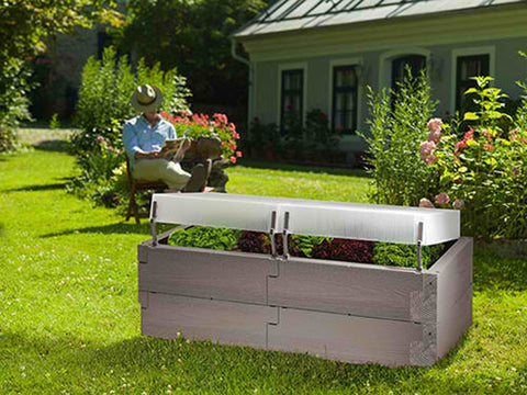 Grey Timber Raised Bed with Covers set up in a garden