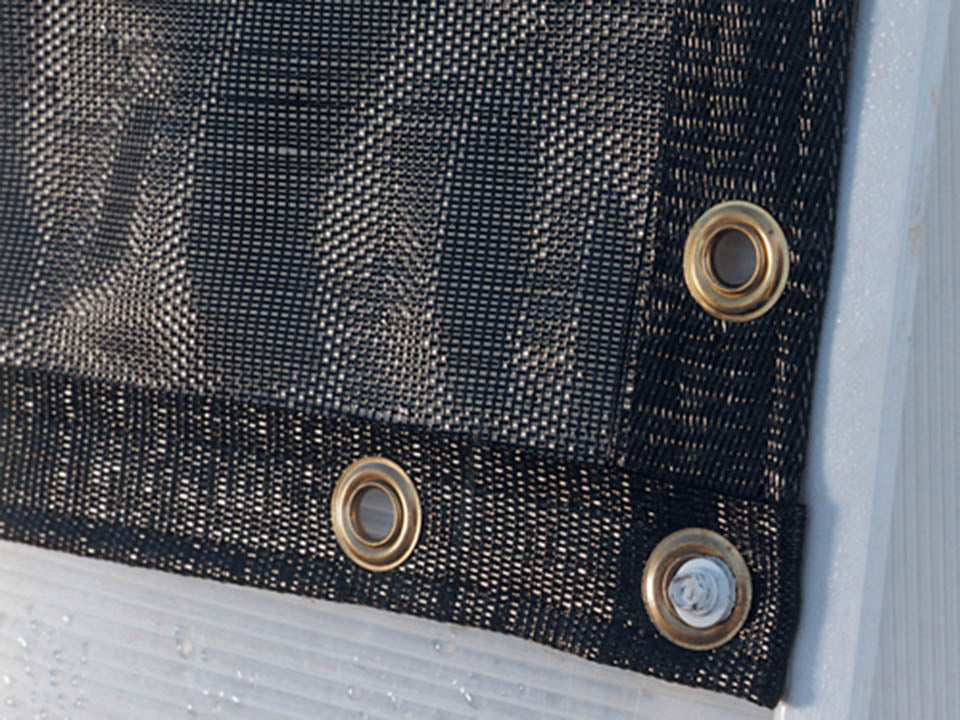 Solexx Black Shade Cloth hemmed edges with grommets