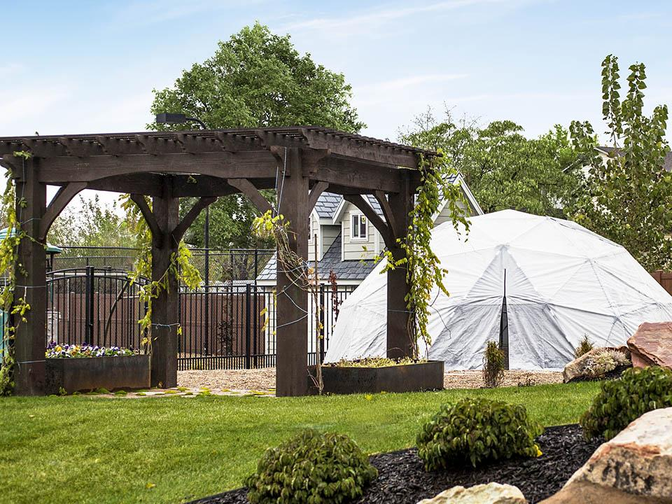 Harvest Right Geodesic Greenhouse in a garden from the front