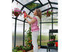 Image of Rion Hobby Gardener 2 Twin Wall 8ft x 20ft Hobby Greenhouse HG7120 - interior view - woman watering plants