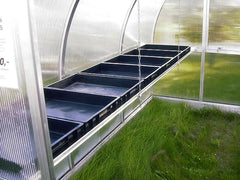 Empty Hoklartherm Greenhouse Seed Trays in a greenhouse