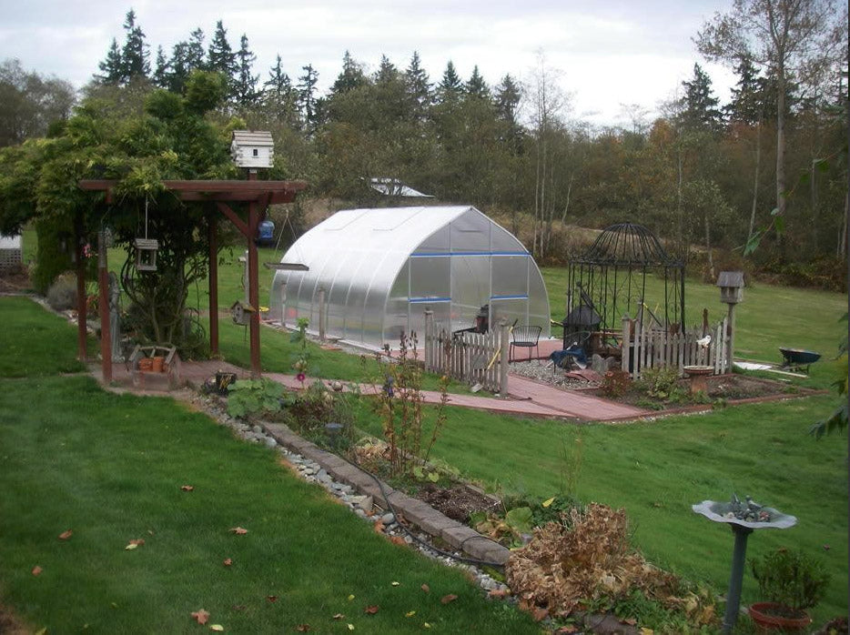 Hoklartherm Riga XL 5 Greenhouse 14x16 set up in a wide garden