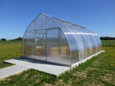 Hoklartherm Riga XL 9 Greenhouse 14x30 set up in a field