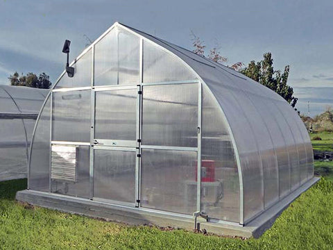 Hoklartherm Riga XL 6 Greenhouse 14x19 front view set up in a field