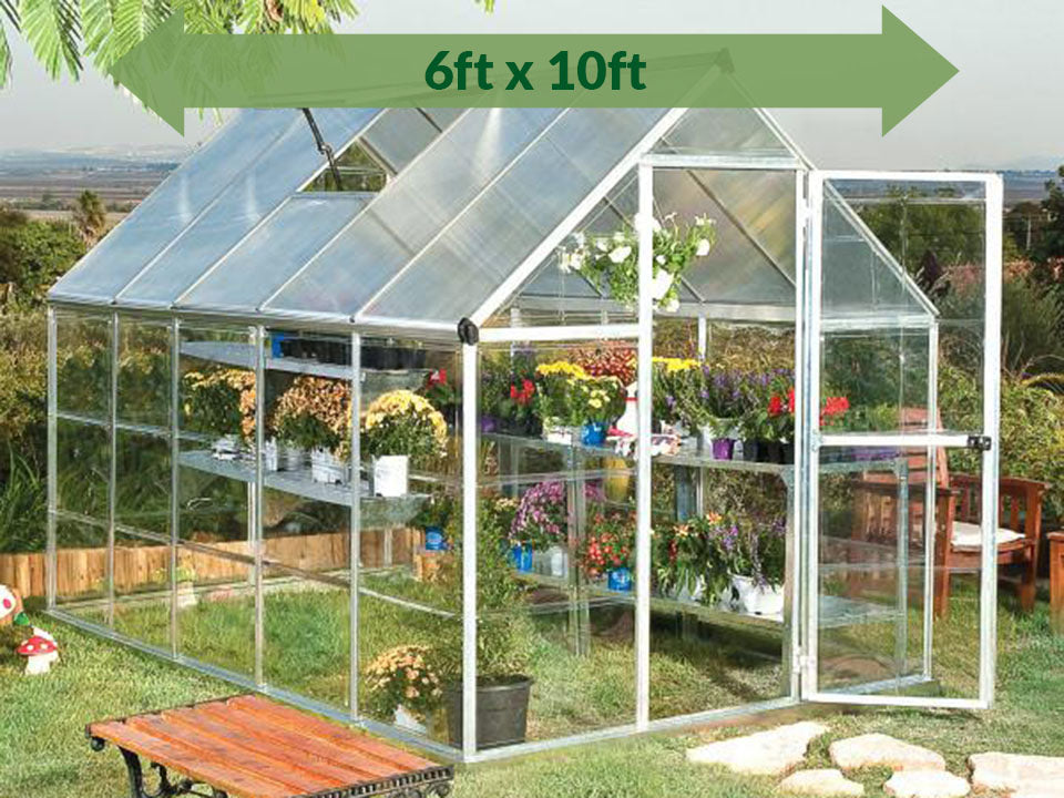 Palram Hybrid 6ft x 10ft Hobby Greenhouse-HG5510 - full view - green arrow on top - in a garden