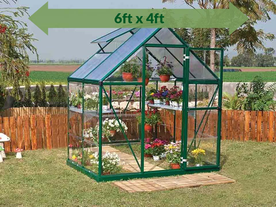 Palram Hybrid 6ft x 4ft Hobby Greenhouse-HG5504(G) - full view - green arrow on top - in a garden