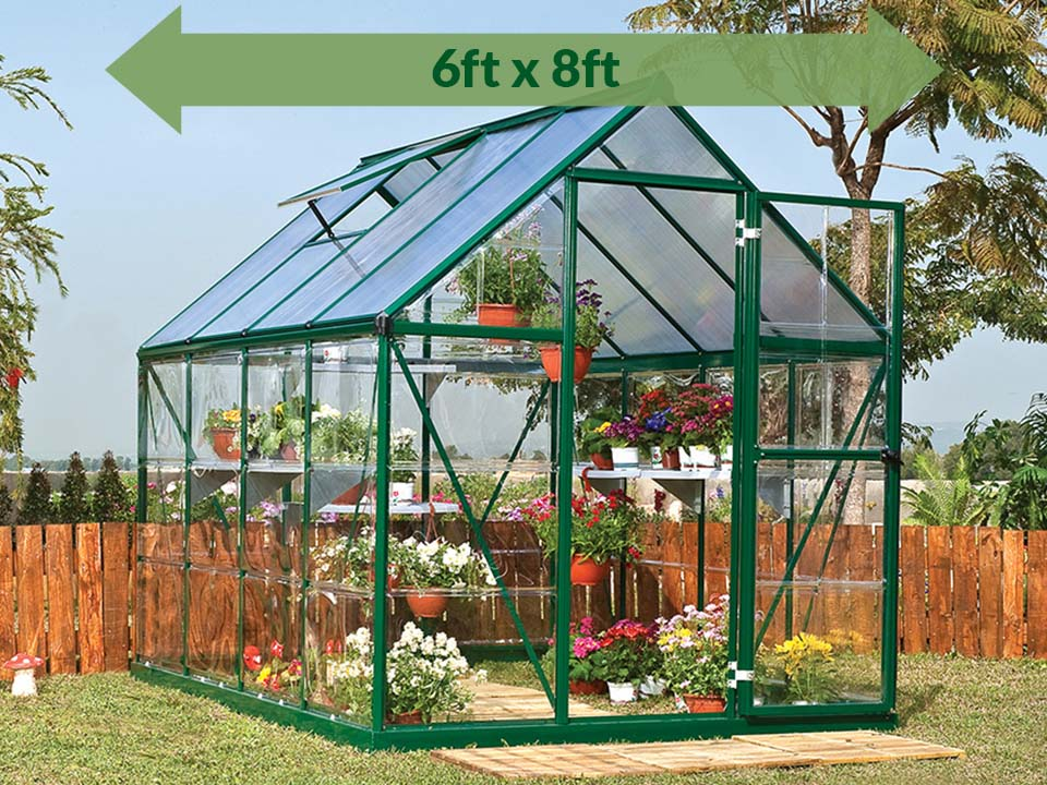Palram Hybrid 6ft x 8ft Hobby Greenhouse-HG5508(G) - full view - green arrow on top - in a garden