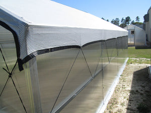 Installed Knitted White Shade Cloth on a greenhouse