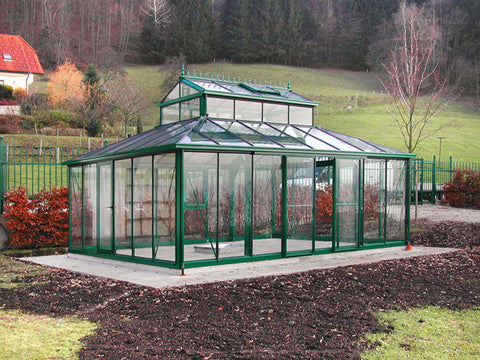 Green Janssens Cathedral Victorian Greenhouse 15ft x 20ft in a garden