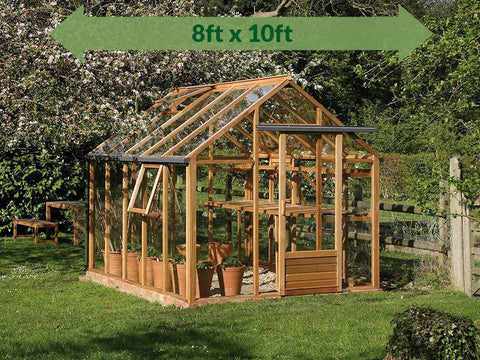 Juliana Classic Greenhouse 8ft x 10ft - slightly open doors - green arrow on top showing dimensions - in a garden