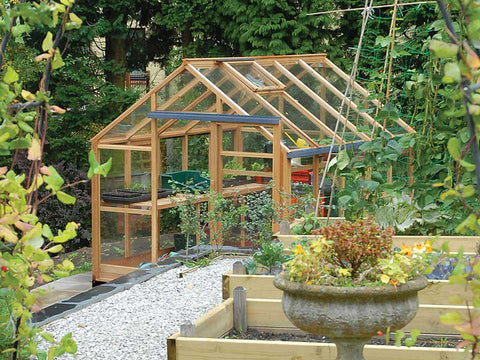 Juliana Classic Greenhouse 8ft x 10ft - closed window - open doors - in a garden