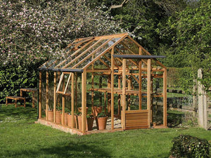 Juliana Classic Greenhouse 8ft x 10ft - slightly open door - opened window and roof vent - in a garden