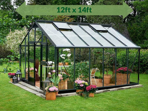 Juliana Gardener Greenhouse 12ft x 14ft - anthracite - 3mm toughened glass - green arrow on top with dimensions - open door - in a garden
